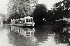 BW192-3-2-2-13-1-579Pleasure boat 'Water Rambler' at Alberts Two Locks near Watford on the Grand Union Canal Description Black and white photograph taken from beside the canal showing the bow of the boat, Eleanor Mitchell can be seen steering the boat with Syd Mitchell inside the boat near the bow. Date 1960