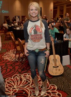 That shirt and that belt! Love the jewelry, too. I would wear non-ripped jeans, though. And those boots are kinda tacky.