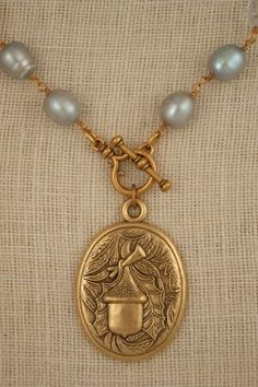 Freshwater pearl neckalce with vintage acorn pendant by ExVoto Vintage Jewelry. #vintagejewelry