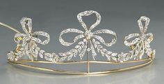 A belle époque diamond and platinum topped gold tiara, Bailey Banks & Biddle, circa 1905  designed as three graduated ribbons set with old European-cut diamonds, completed by a foliate diamond garland and accented by small florette clusters; signed BB for Bailey Banks and Biddle, no. 35365; estimated total diamond weight: 3.00 carats. Click to enlarge: http://assets3.pinimg.com/upload/137641332332750061_xbXvBrKi.jpg