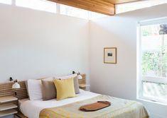 minimalist modern bedroom with yellow and wood details. / sfgirlbybay