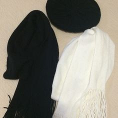 "REDUCED Bundle 2 Cozy Knit Scarves and a Beanie Bundle of two cozy scarves. Both are 100% acrylic. The white one is a slightly ivory off white color. It's never been worn, but has a slight snag. The black one has never been worn either, but has some slight fuzzing and pilling from when I washed it. The white one is approximately 9"" x 68"" and the black one is 60"" x 8.5"" including the fringe.  final price ❌ I do not trade. Please do not ask. Macy's Accessories Scarves & Wraps"