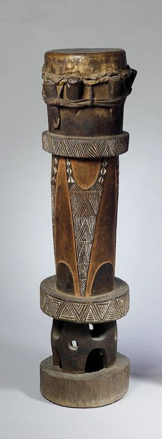 Africa | Drum from the Congo region; elongated cylindrical form the body with incised geometric decoration, stained black and white, 108 cm