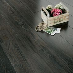 Series Inspire 8mm Gloss Black Oak Laminate Flooring