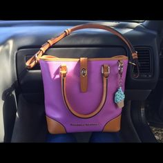 Dooney & Bourke Cayden Lilac Thinking of selling my dooney and bourke Claremont medium Lilac handbag. Great condition super light scratches on bottom corners  though not noticeable since they are light. Inside stitching of the handle has I guess a scratch or something but not noticeable as it is on the inside . And the longer strap (I was told not Crossbody) and does not come off I purchased like this looks like they changed size of length but the women told me it makes no difference.  No…