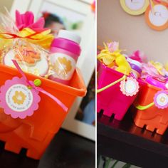Party favors in sand buckets for Hawaiian birthday party. Via hostessblog.com