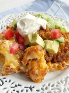Taco biscuit bake is an easy & simple one pot meal.Puffed up refrigerated biscuits smothered in a beefy taco mixture and topped with melted cheese. Customize with your favorite taco toppings and you have a delicious dinner that the entire family will love!