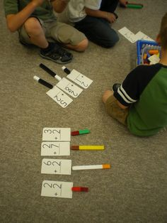 Kindergarten Modification; make numbers on cards two different colors.  Have students use the color cubes matching the number colors.