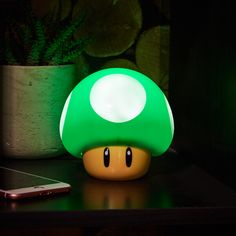 Give your ambient lighting game a much-needed power up with the Super Mario Mushroom Light. Rather than endowing you with extreme speed, strength or agility Super Mario Room, Super Mario Nursery, Night Light, Light Up, Mushroom Lights, Cute Room Decor, The Bell Jar, Gadgets, Jar Lights