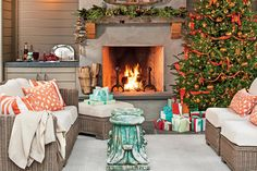 Set a Holiday Scene In Your Outdoor Room - 100 Fresh Christmas Decorating Ideas - Southernliving. This warm and cozy backyard retreat is decorated for the season. A beautiful Christmas tree takes center stage while the mantle is adorned with fresh greenery. A simple wreath above the fireplace completes the stunning scene.