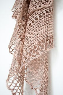 Parasol is a crescent shape shawl with a fun twist on decorative eyelets. It is worked top down with just one skein of fingering weight yarn.