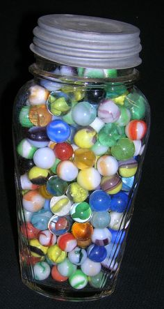 Marbles...I did this with some marbles that my husband had kept from his childhood. Makes a pretty, colorful display piece.