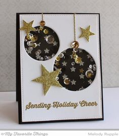 My first step was to add the stars to the Black Licorice Card Stock. I used the Starry Night Stencil and white embossing paste and sprinkled glitter on the embossing paste before it dried. In the Smooth White Card Stock card front I cut two circles with the Circle STAX Die-namic 1 and 2.  Next I add a clear acetate behind the ornaments and then a layer of a thin foam to contain the sequins inside the circle. When I make shaker cards I like to glue a few sequins in place at the top and then…