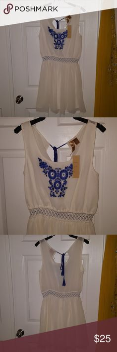 Embroidered sleeveless dress Gorgeous blue embroided ivory dress with elastic band around the waist. Ties in back with cute blue tassles. Brand new with tags never worn. Perfect for summer or a festival! Bohemian vibes! Waist 13in unstretched. Any question and offers are welcome!! whispers Dresses Midi