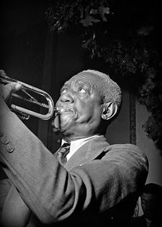"'William Geary ""Bunk"" Johnson, pioneer jazz cornetist and trumpeter, was born in New Orleans, LA, on December 27, 1889."