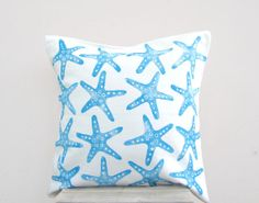 Nautical decor pillow: starfish print in blue on white throw pillow cushion cover, beach cottage decor, nautical nursery on Etsy, $39.00