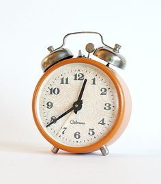 Orange clock from Armenia mechanical alarm by ClockworkUniverse, $39.00