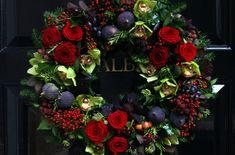 Christmas wreath:  figs, roses, and orchids
