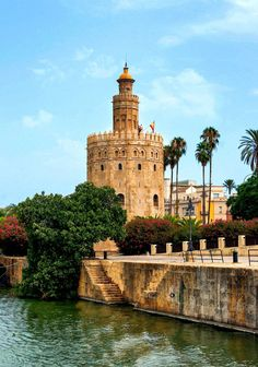 "Torre del Oro, Seville. - The Torre del Oro (English: ""Tower of Gold"") is a dodecagonal military watchtower in Seville, southern Spain, built by the Almohad dynasty in order to control access to Seville via the Guadalquivir river.Was built 1220-1221, by order of the Almohad governor of Seville Abu l-Ulà. Constructed in the first third of the 13th century, the tower served as a prison during the Middle Ages. Its name comes from the golden shine it projected on the river Guadalquivir."
