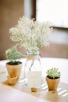 Baby's breath flowers with succulents for decor of wedding table centerpiece / http://www.himisspuff.com/rustic-babys-breath-wedding-ideas/12/