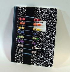elastic strap for crayons/pencils slides over comp. notebook. Get the Comp. notebook for $0.20 at walgreens!