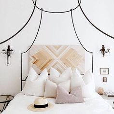 all white bedroom and this wood headboard