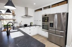 #repost --> @forevermarkcabi . Spotted on @hgtv #TyBreakers with @thetypennington. Featuring Ice White Shaker cabinet. 🤩 Its a beauty. All White Kitchen, Eat In Kitchen, Home Decor Kitchen, Kitchen Design, Kitchen Ideas, White Shaker Cabinet Doors, Bathroom Cabinetry, Buying A New Home, Wooden Dining Tables