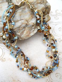 Multi strand necklace, cream, brown, light blue, statement necklace, woven, twisted, freeform: Sand and Sea