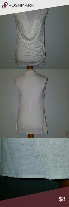 Off White deep v sleeveless tunic Lightweight material, soft and comfy. Deep v in front. Worn a few times. Old Navy Tops