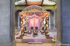 An Indian bride and groom wed in a traditional Hindu wedding ceremony. Wedding Mandap, Desi Wedding, Wedding Stage, Wedding Ceremony, Wedding Bells, Indian Wedding Decorations, Ceremony Decorations, Mumbai, Gujrati Wedding