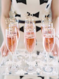"""Gold """"cheers"""" drink stirrers added a splash of fun to the glasses of pink champagne."""