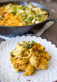 This tasty vegan macaroni and cheese is made with butternut squash, roasted garlic, a lot of nutritional yeast, and arrowroot to make it thick and creamy.
