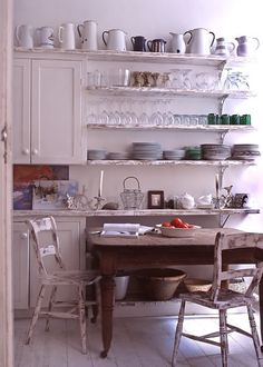 Inspiration: maybe shelves in the dinning room with eclectic, blue, green, and yellow drinking glasses.