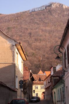 """Check out the """"Brasov"""" sign on the hill"""