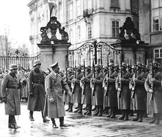 Later that same day - March 15th 1938 - Hitler is in Prague, capital of the former Czechoslovakia - and reviews his own troops.