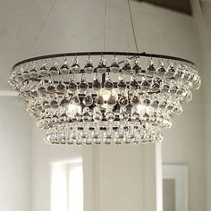 This show stopping chandelier is made up of more than 150 solid glass orbs, each one individually hand blown with little teardrop-shaped hanging loops. Dan