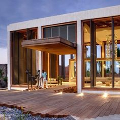 Long Beach Hotel by Keith Interior Design & M2k Architecture (love the wood patio jagged edge with bordering stones)
