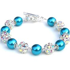 Turquoise pearls and sparkling rhinestones have been used in this bracelet which would make a lovely spring or bridesmaid accessory. I have strung