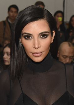 Kim Kardashian Medium Straight Cut - Kim Kardashian wore her mid-length locks straight with a side part at the Robert Geller fashion show.