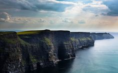 Cliffs of Moher, Ireland    Need I say more. The experience of standing on the cliffside looking over the water....