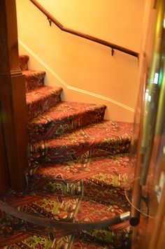 This is the stairway coming down from the rear of the second floor of Graceland to the kitchen.
