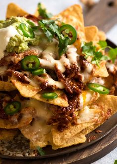 Chicken Nachos is everything you know and love about nachos, made with juicy shredded Mexican CHICKEN! With mandatory melted cheese, quick guac and a dollop of sour cream, this nachos recipe is weekend worthy yet easy enough for dinner midweek. Chicken Nachos Recipe, Chicken Recipes, Healthy Chicken, Grilled Chicken, Cheesy Nachos, Homemade Nachos, Mexican Shredded Chicken, Shredded Chicken Nachos, Recipetin Eats