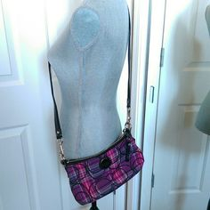 Coach cross-body bag Super cute cross body mini bag, perfect for wallet, phone, keys and lip gloss! Long strap removable for just over the shoulder wear. Love the colors of this purse, I just never use it. Like new! Canvas Coach Bags Crossbody Bags