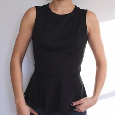 Black Peplum Top Black Peplum Top with sheet detail on the shoulder and back. Size small worn only once! No trades sorry! Mossimo Supply Co. Tops Blouses