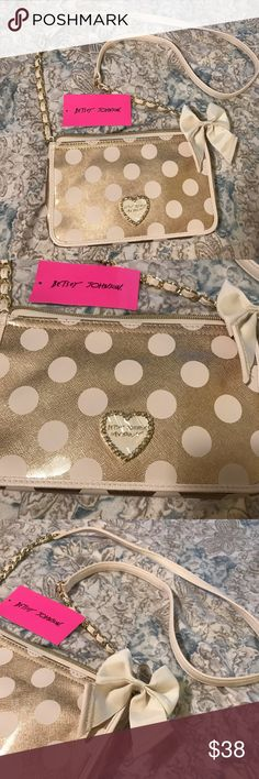Betsey Johnson White & Gold Crossbody Wallet Purse Adorable Betsey Johnson crossbody shoulder bag! Smaller size with a zip pocket and opening front flap with spaces for cards and ID's. Brilliant metallic gold color with white polka dots, and a white/gold chain strap accented with a white bow. Brand new with tags! Betsey Johnson Bags Crossbody Bags