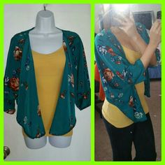 Floral Cardigan Floral cropped Cardigan. Size Small to Medium.   Sleeves: 19 inches Height: 23 inches Width: 29 inches Back: 17 inches Tops Crop Tops