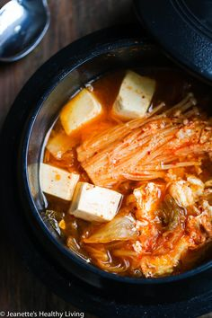 Spicy Kimchi Tofu Mushroom Egg Soup - this spicy vegetarian soup is healthy bowl of comfort on a cold winter day