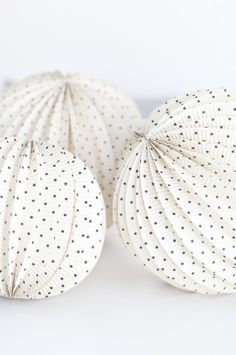 Black dot paper lanterns : these would be so pretty grouped at the ceiling in a kid space