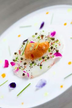 "Uni ""sea urchin"" colorful plating on egg white with scallion, capers & red onion."