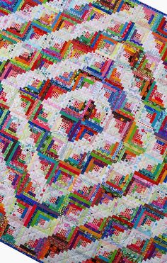 Log Cabin Quilt. Scrappy. Set on-point. Edges of blocks look like prairie points, or zig-zag. Red Pepper Quilts: Step Back in Time.